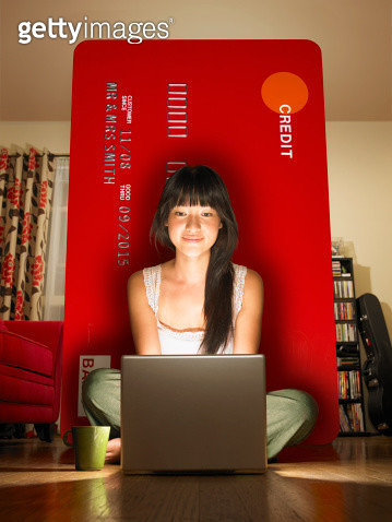 A young woman shopping online with credit card - gettyimageskorea
