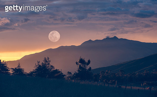 In-camera double exposure of the full moon over the Ecuadorian Andes. - gettyimageskorea