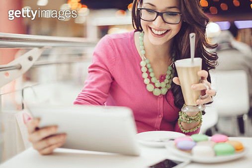 Young woman in a coffee shop - gettyimageskorea