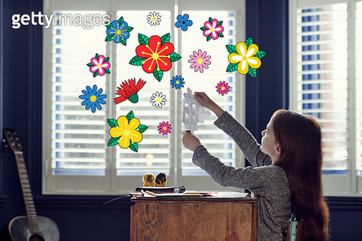 Girl creating shapes with imaginary flowers - gettyimageskorea