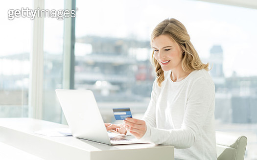 Woman shopping online at home - gettyimageskorea