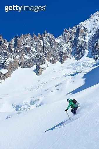 Male skier skiing steep downhill on Mont Blanc massif, Graian Alps, France - gettyimageskorea