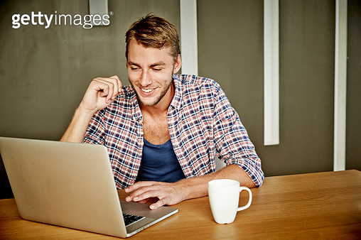 Man in checkered shirt at home - gettyimageskorea