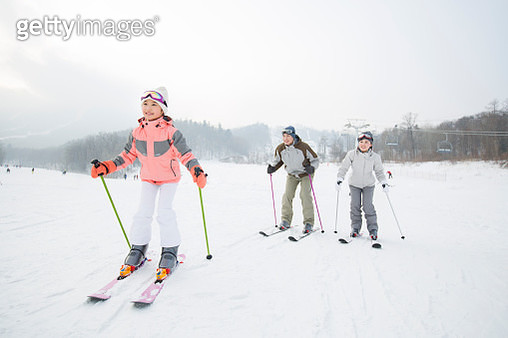 Young family skiing in ski resort - gettyimageskorea