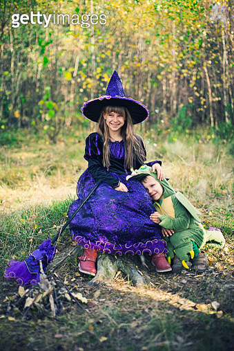 Happy little witch and pet her dragon. - gettyimageskorea