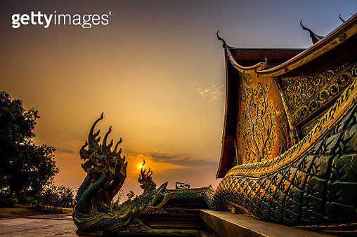 sunset at illuminated temple of Wat Pu Praw Sirinthorn - gettyimageskorea
