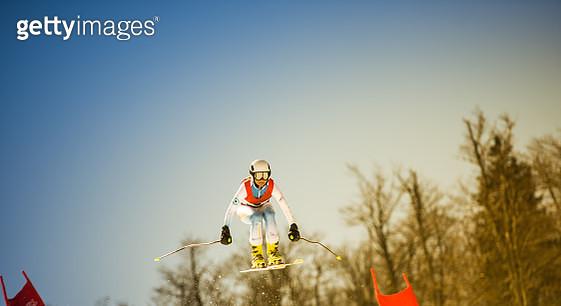 Professional Alpine Skier in Mid-Air - gettyimageskorea