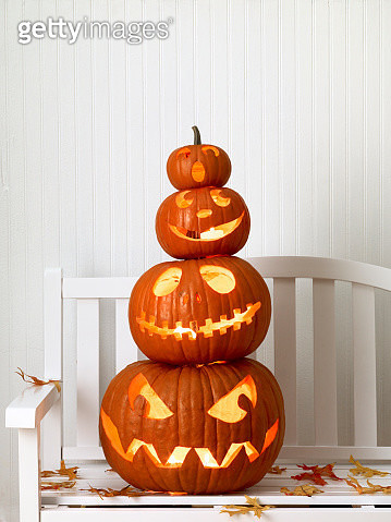 Stack of Carved Pumpkins on White Bench - gettyimageskorea