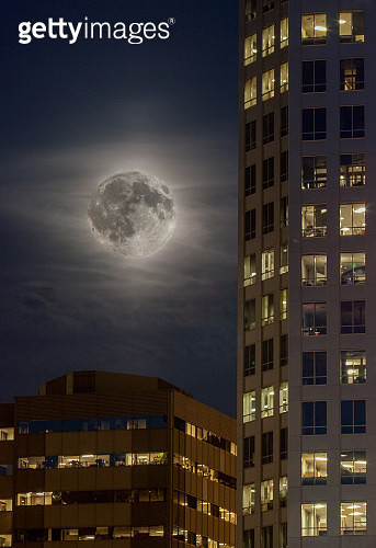 Full Moon over high rise buildings - gettyimageskorea