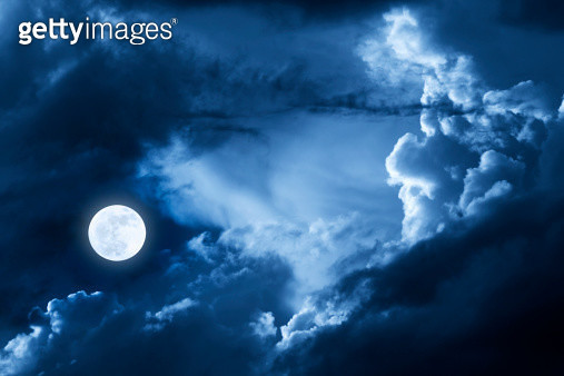Dramatic Nighttime Clouds and Sky With Beautiful Full Blue Moon - gettyimageskorea