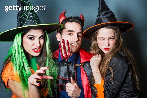 Group shot of friends posing in halloween costumes - gettyimageskorea