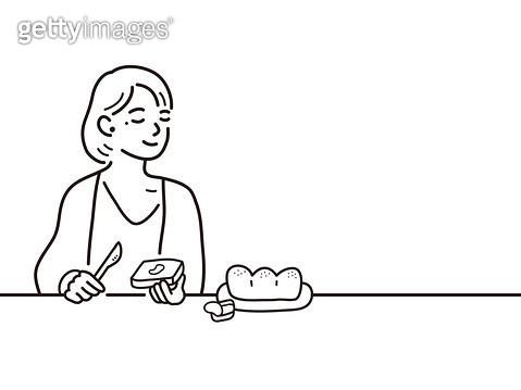 빵을 먹고 있는 사람 - gettyimageskorea