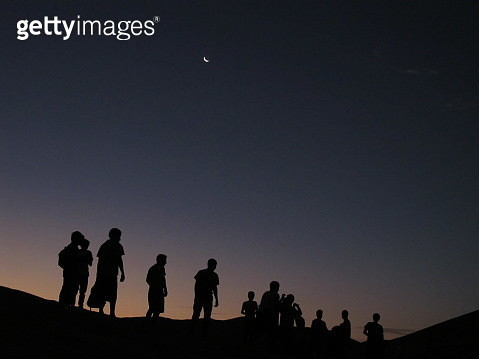 Silhouette Men Standing On Mountain Against Clear Sky At Dusk - gettyimageskorea