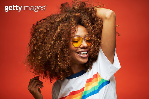 Beautiful young woman with afro hair in summer themes. Made in Barcelona with model from Venezuela. - gettyimageskorea