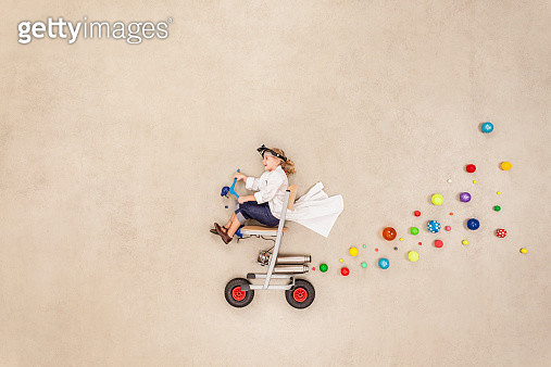 Girl trying out new vehicle - gettyimageskorea