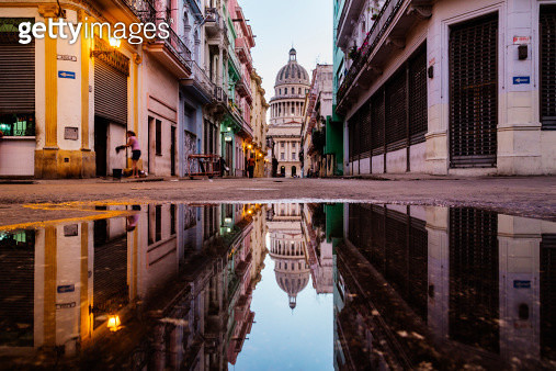 Ornate city building reflected in puddle, Havana, Cuba - gettyimageskorea