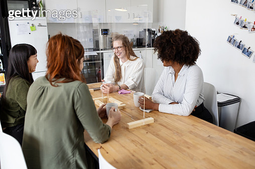 Business women at office cafeteria with glass partition - gettyimageskorea
