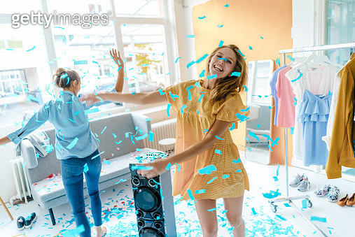 Two excited young women having a party - gettyimageskorea