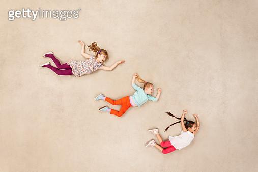 Children flying in the air - gettyimageskorea