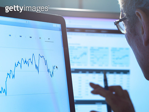 Financial services, stock analyst researching share price data of a company on the computer - gettyimageskorea