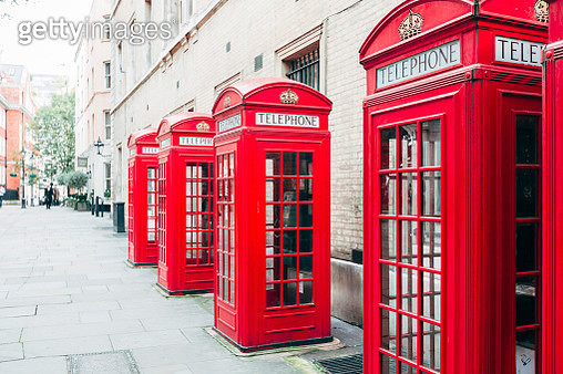 Red telephone booths on the street in London, England, UK - gettyimageskorea