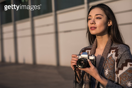 Girl with digital camera - gettyimageskorea