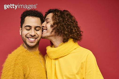 Colourful studio portrait of a gay male couple - gettyimageskorea