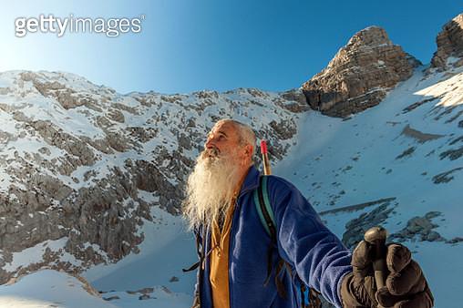 Happy Senior Climber with Long Beard, Kanin, Julian Alps, Europe. - gettyimageskorea