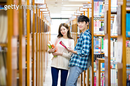 Korean, college student, couple, university, library, study, book, reading, - gettyimageskorea