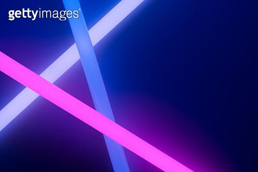 Colorful Glow Sticks Crossing in the Dark. - gettyimageskorea