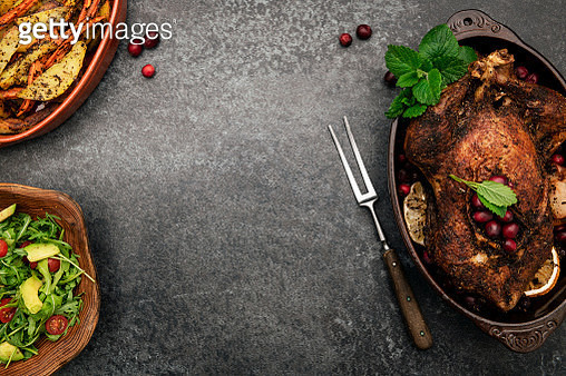 Roasted chicken with spices on table - gettyimageskorea