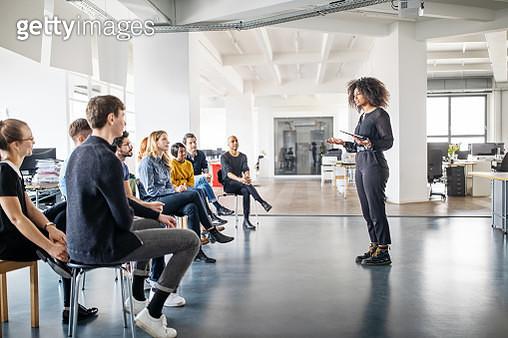 Woman addressing her team - gettyimageskorea