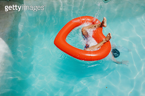 Man's feet protruding as he dives through heart-shaped inflatable - gettyimageskorea