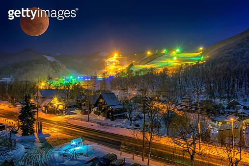 Japan Super bloody moon and winter landscape view, Skiing resort at night, Otaru, Hokkaido. - gettyimageskorea