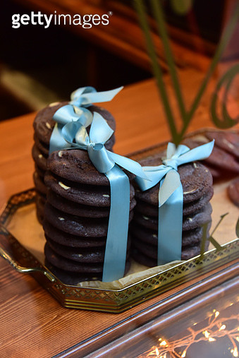 Chocolate cookies stacks tied with blue ribbon - gettyimageskorea