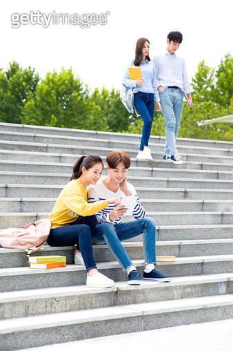 Koreans, college students, campus (university), stairs, sitting (body posture), couples - gettyimageskorea