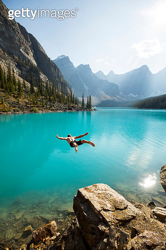 Jumping into a cold mountain lake - gettyimageskorea