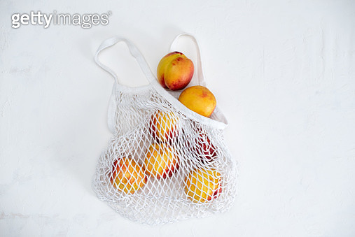 zero waste shopping. cotton bag full of vegetables on yellow background - gettyimageskorea