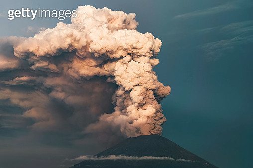 Smoke Emitting From Volcanic Mountain Against Sky - gettyimageskorea