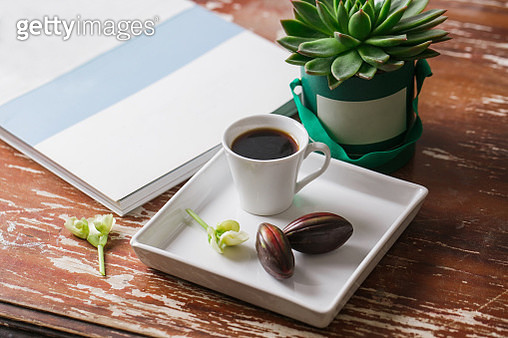 Hipster Easter Flat Lay Photography: Cup Of Coffee, Chocolate Egg, Old Magazine, Succulent - gettyimageskorea