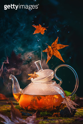 Glass teapot with a tiny elven castle inside. Magical food photography, Halloween drink concept with copy space - gettyimageskorea