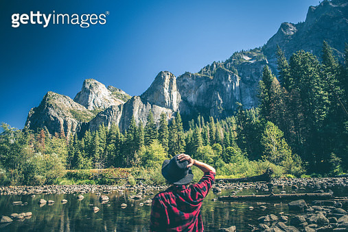 Young woman hiking in majestic landscape - gettyimageskorea