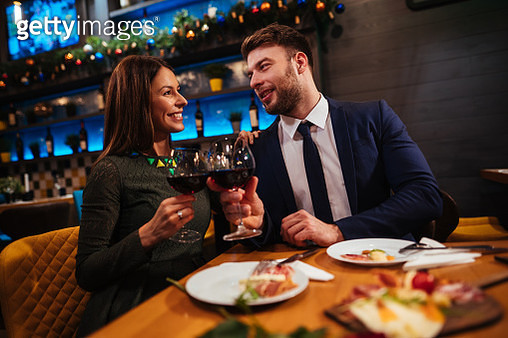 Couple enjoying red wine on Valentine's Day - gettyimageskorea