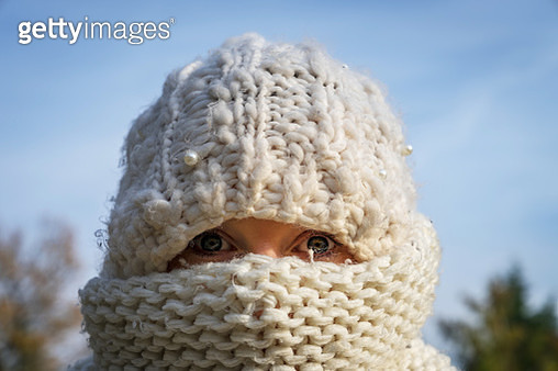 Close-Up Portrait Of Woman Wearing Scarf On Face Against Sky - gettyimageskorea