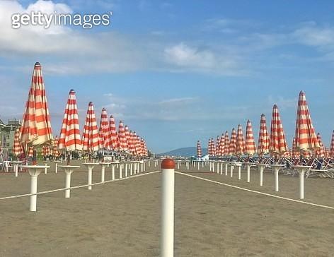 Rows Of Closed Beach Umbrellas - gettyimageskorea