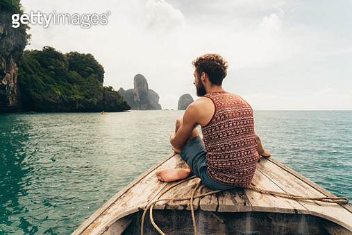 Man sitting on the boat - gettyimageskorea