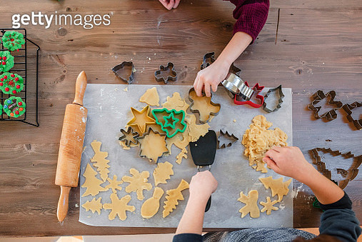 Overhead view of two children making Christmas cookies - gettyimageskorea