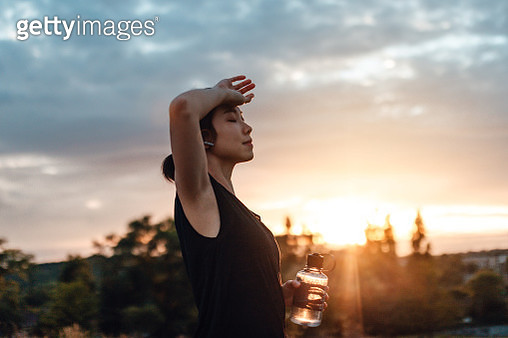 Sport lady drinking water after daily training - gettyimageskorea