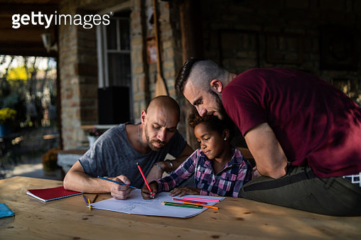 Gay couple spending creative time with their daughter - gettyimageskorea