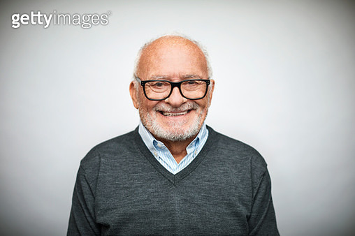 Portrait of confident senior businessman on white background. Satisfied professional is wearing eyeglasses. He is smiling in studio. - gettyimageskorea